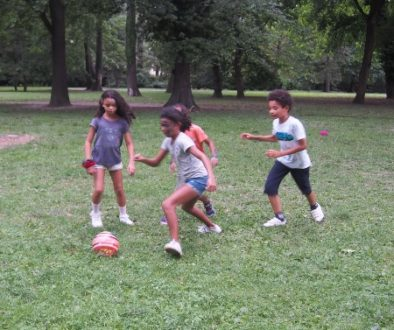 Kinds of mixed races playing footbal together during the ASU safari picnic