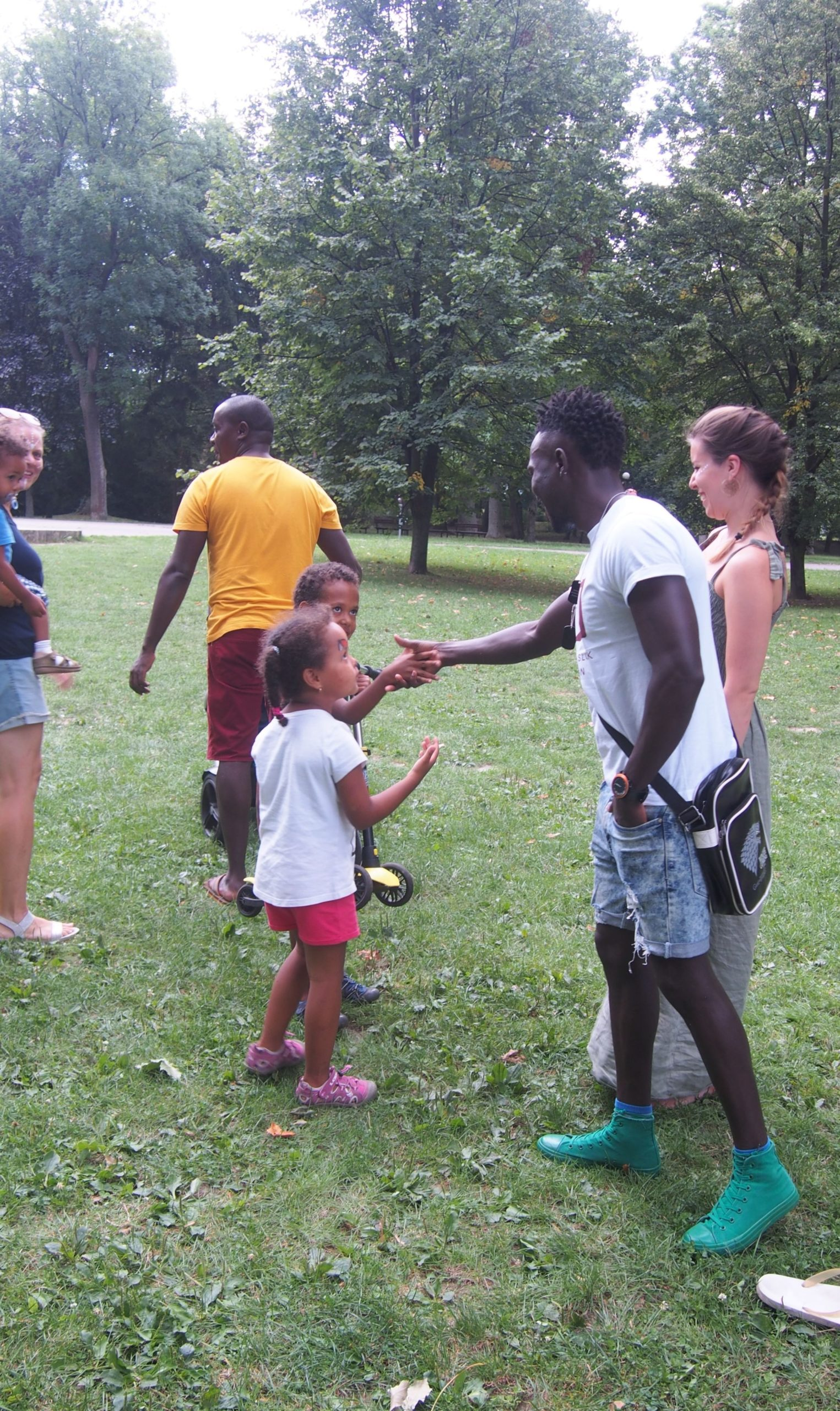 ASU team members playing with mixed kids at the safari picnic