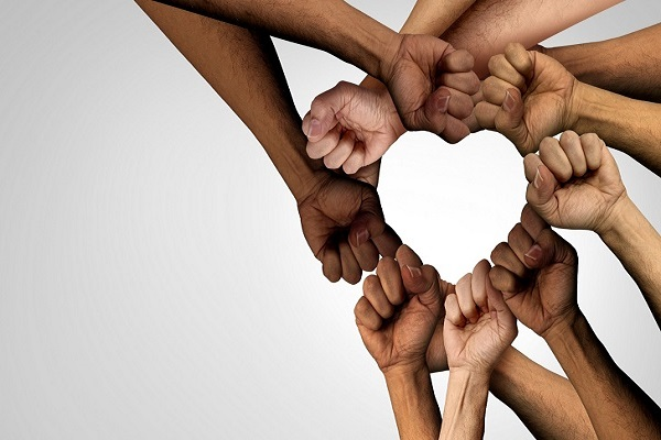 Power of diveristy _ peole joining hands to make a heart shape