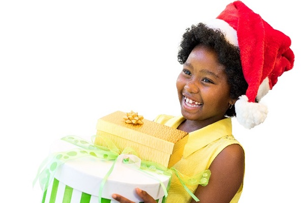 a happy young girl with her Christmas gifts