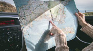 a traveler reading a map