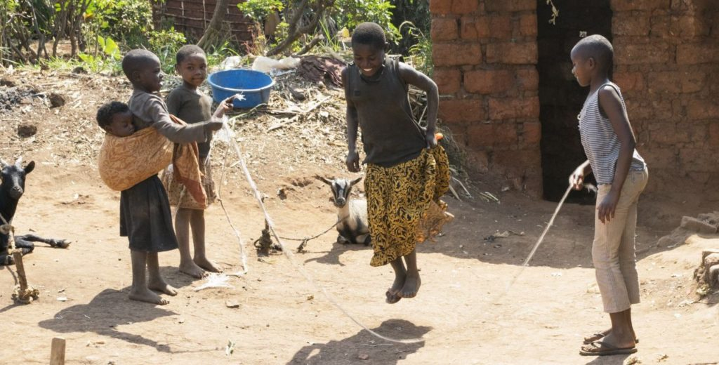 African girls skipping a rope